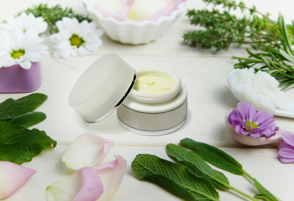 Handmade face cream and herbs around it