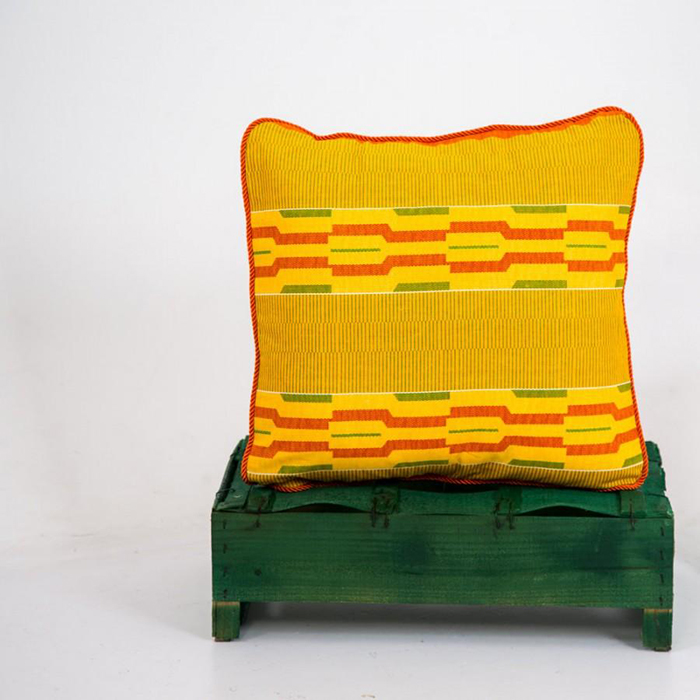 Yellow textile pillow with ethnic motives