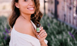 Girll with essential oil in her hand