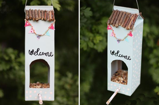 Recycled milk plastic bottle bird house saying welcome
