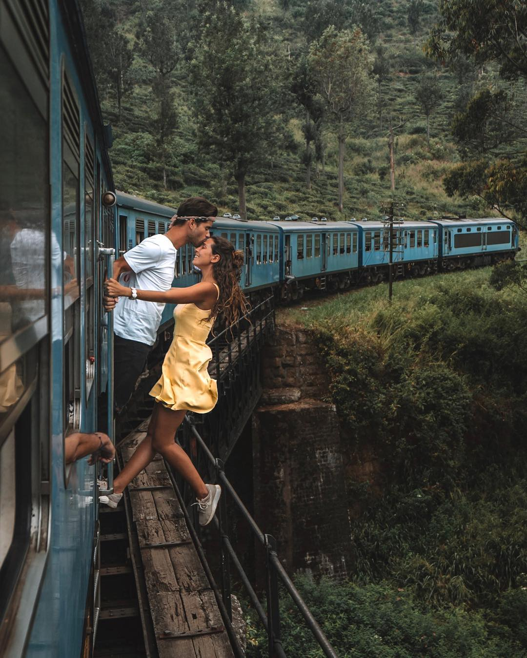 Girl and a boy kissing in train