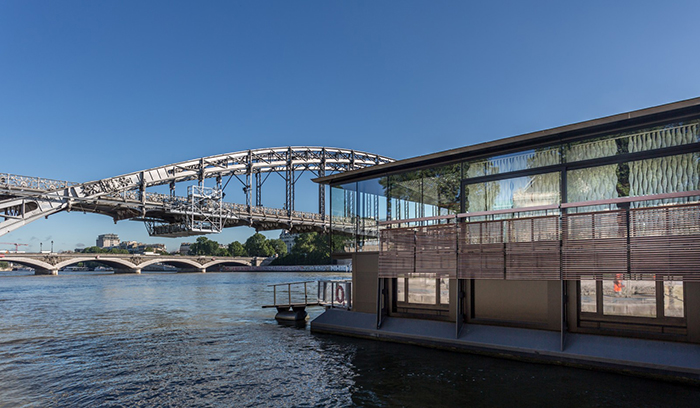 Moder floating hotel with a view on a river and bridges