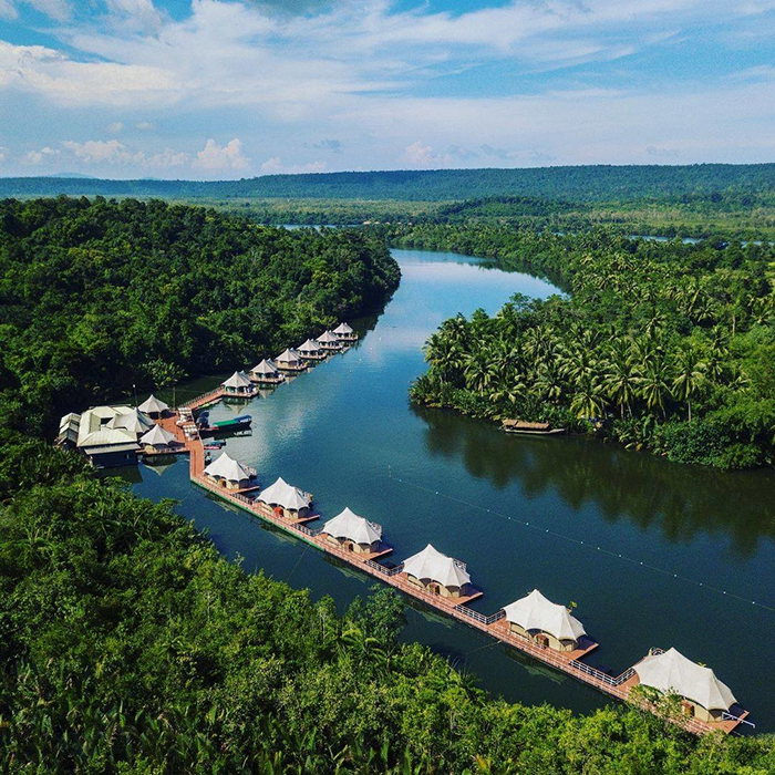 Floating hotels on a river with a nice nature around