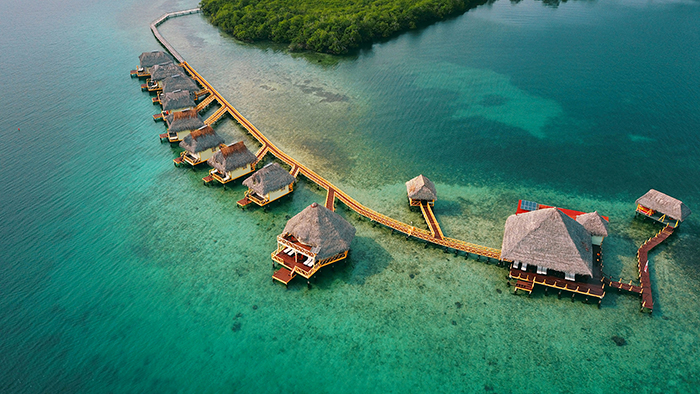 Floating hotel lodges put all next to each other over the sea