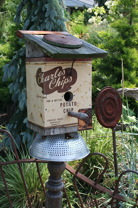 Potato chip box converted into a birdhouse