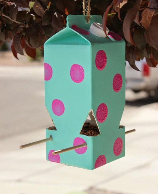 Recycled plastic bottle bird house with nice decor of big dots