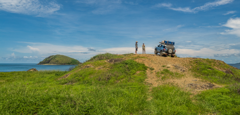 Two persons exploring Cape York Peninsula with their sport car