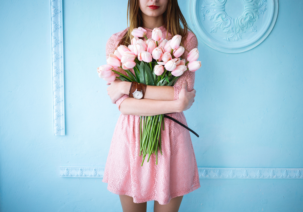 Girl in a dress holding roses