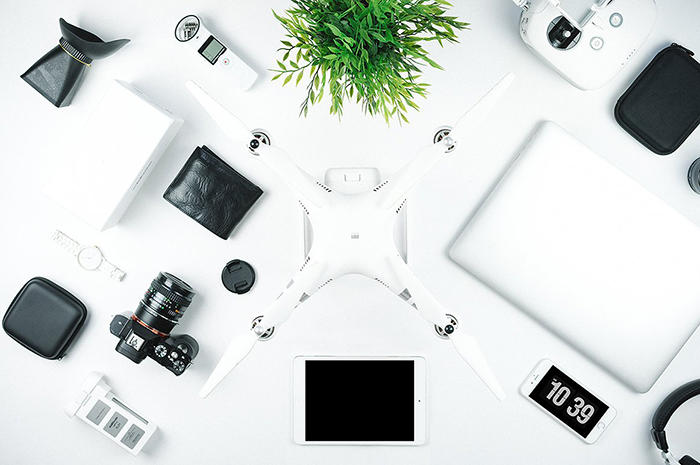 Camera and other travel gadgets on a desk