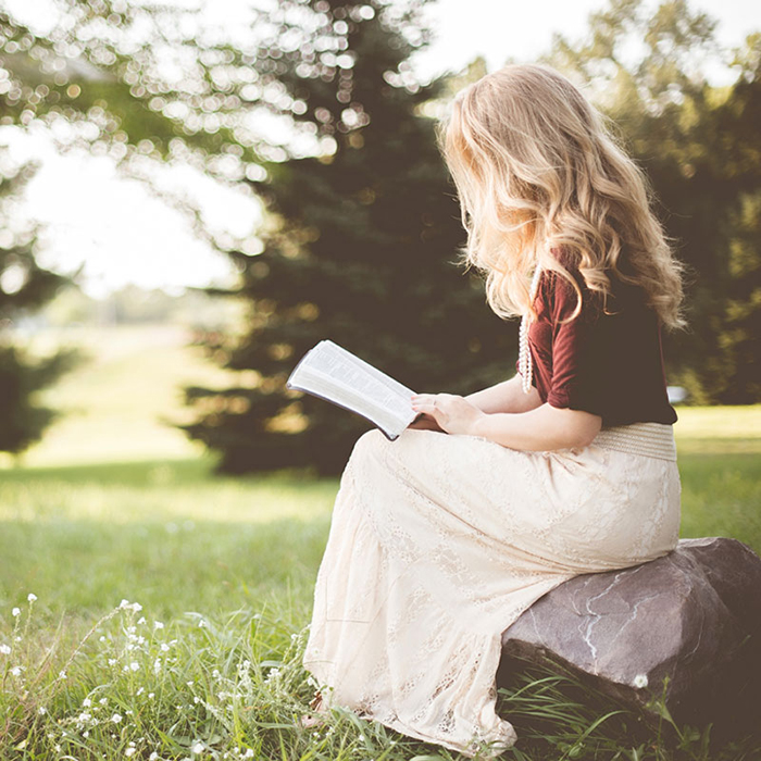 Girl reading outdoors