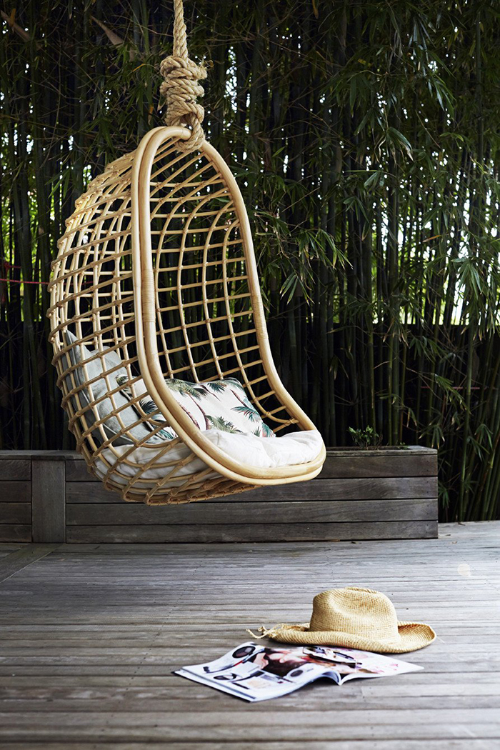 Hanging arch chair surrounded with calm nature