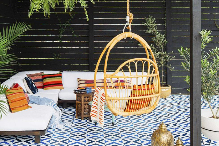 Hanging arch chair in a yard