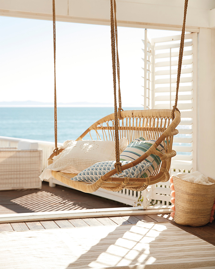 Hanging arch chair in a summer house