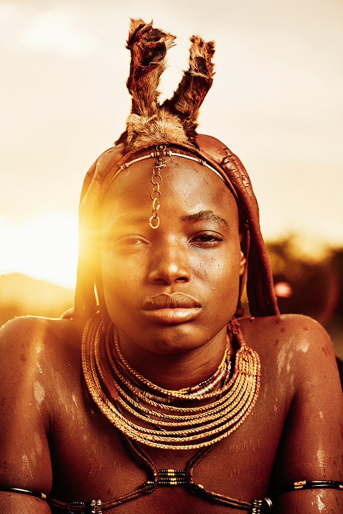 Himba person from Namibia with red clay on the face
