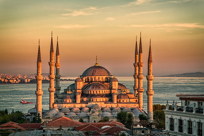 Sunset in Istanbul with a view of a mosque and the Bosphorus