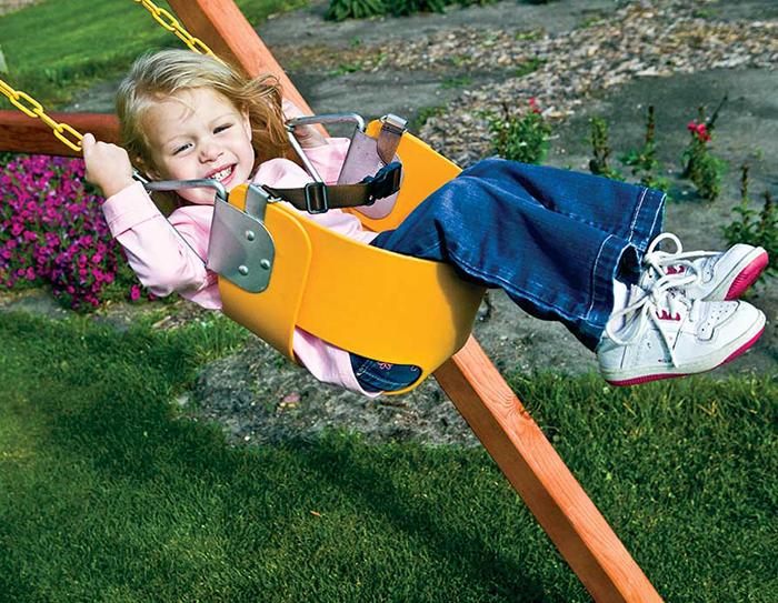 Happy girl on a bucket swing