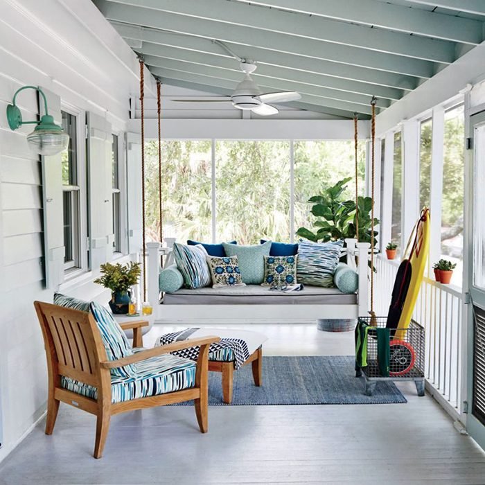 Modern Wooden Porch Swing in a nicely decorated balcony