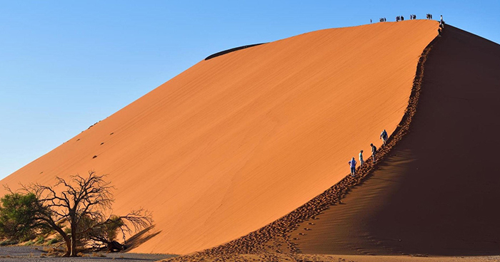 People walking around a desert in Namibia