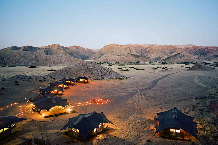 Guest houses in Namibia with cozy lights and small hills around