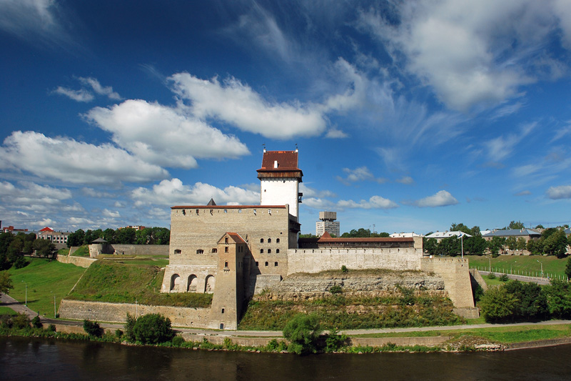 Beautiful Narva castle with green surroundings and a river