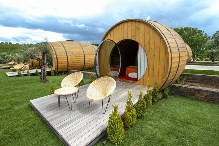 The wine barrel rooms with their small balconies in front and surrounded with good nature