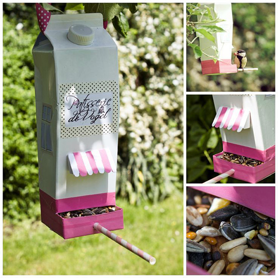 Recycled plastic bottle bird house hanging on a tree