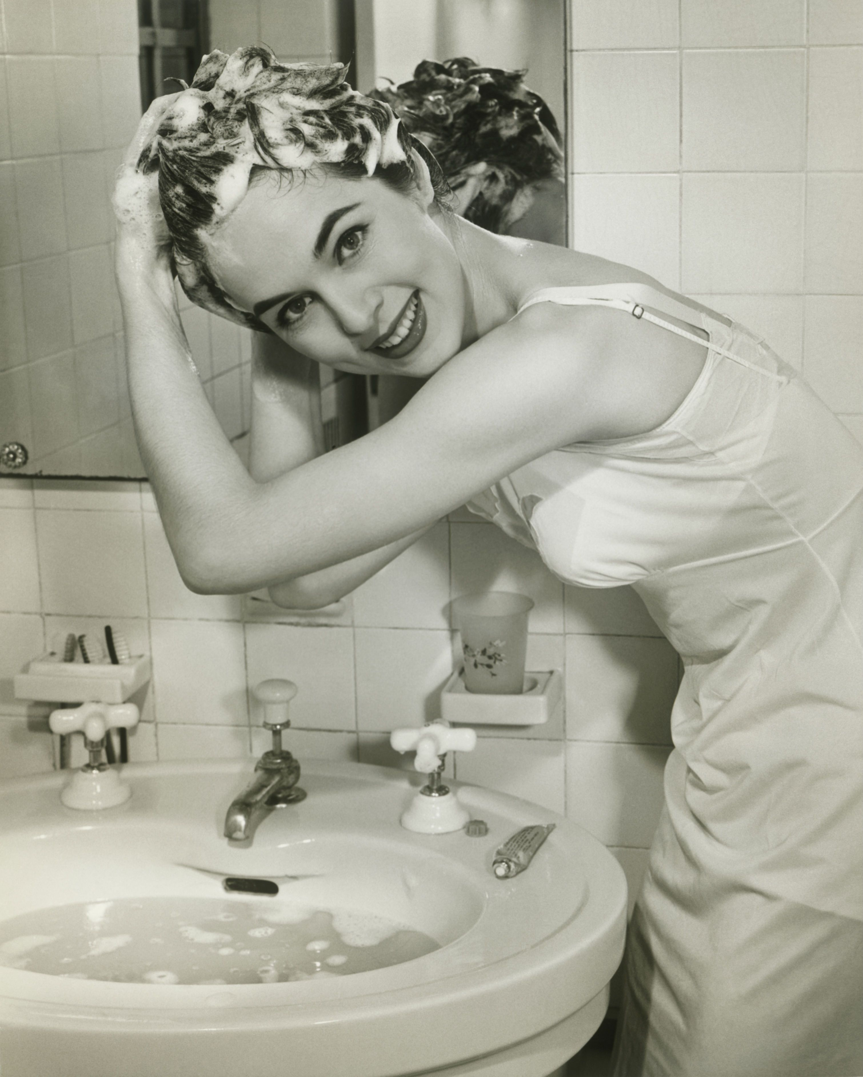 Retro girl washing her hair
