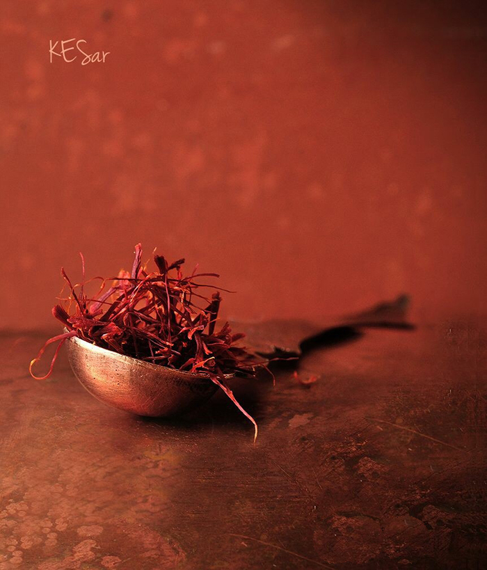 Dried saffron placed in a metal spoon