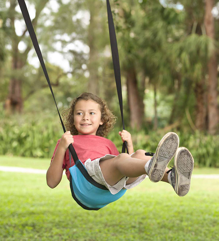 Little girl on a sling swing