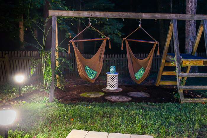 Swing sets in the patio on a summer night with peaceful lighting