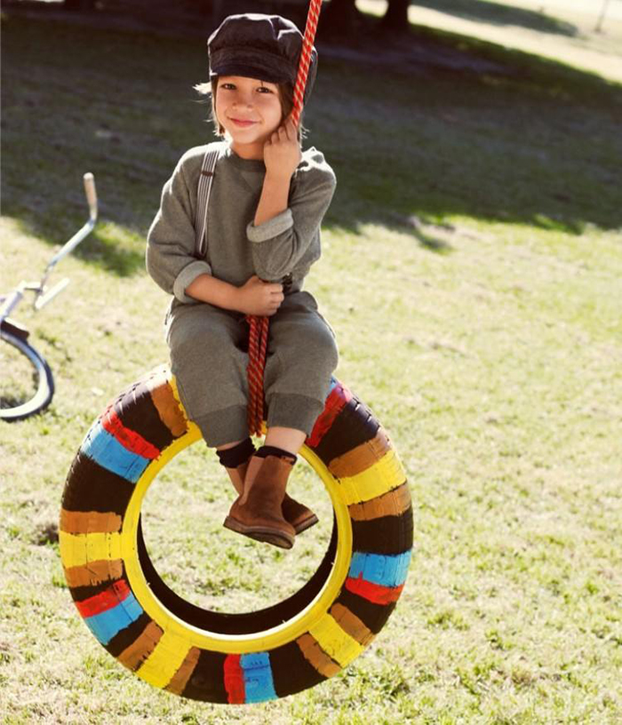 Girl on a tire swing