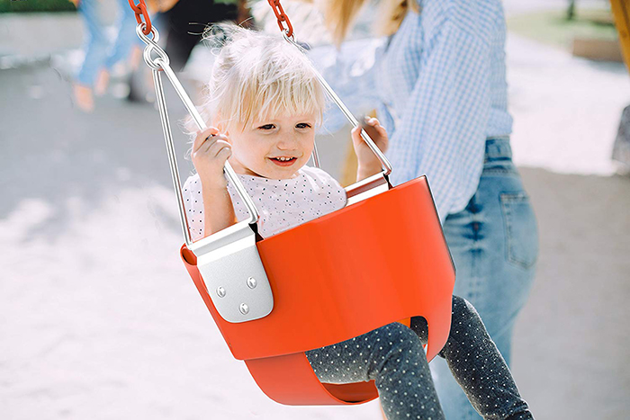 Toddler on a bucket swing