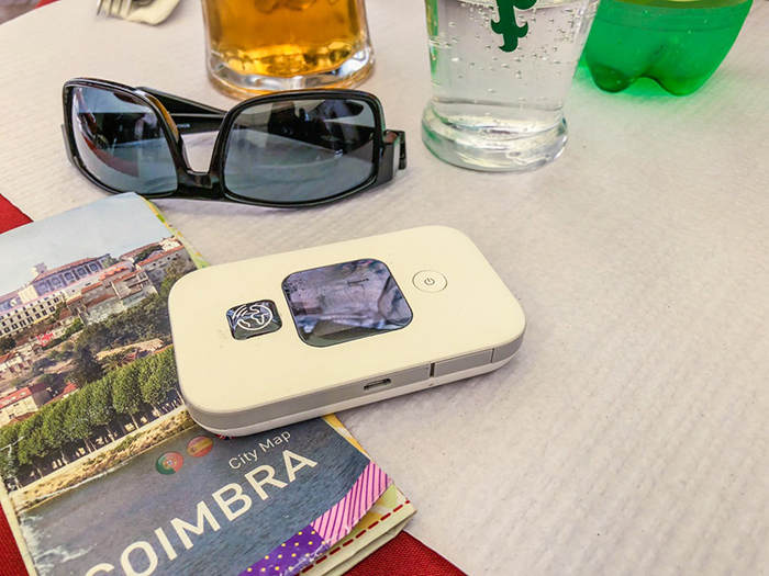 Portable WI FI Hot Spot, sunglasses and a City Map of Coimbra