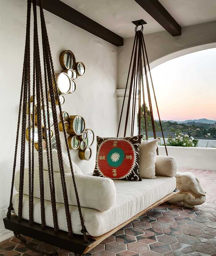 Vintage wooden porch swing on a balcony with a nice view on nature