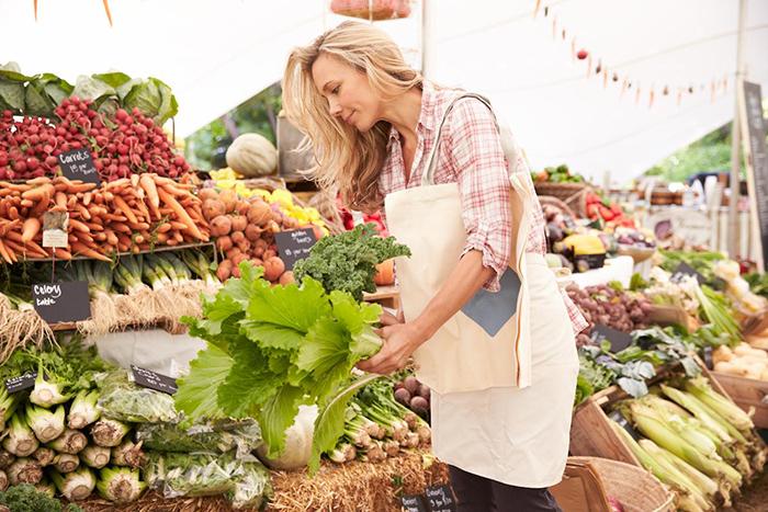 Woman doing groceries with reusable bag