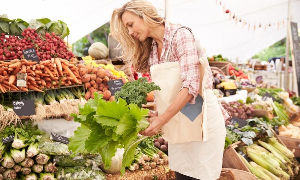Woman doing the groceries using reusable grocery bag