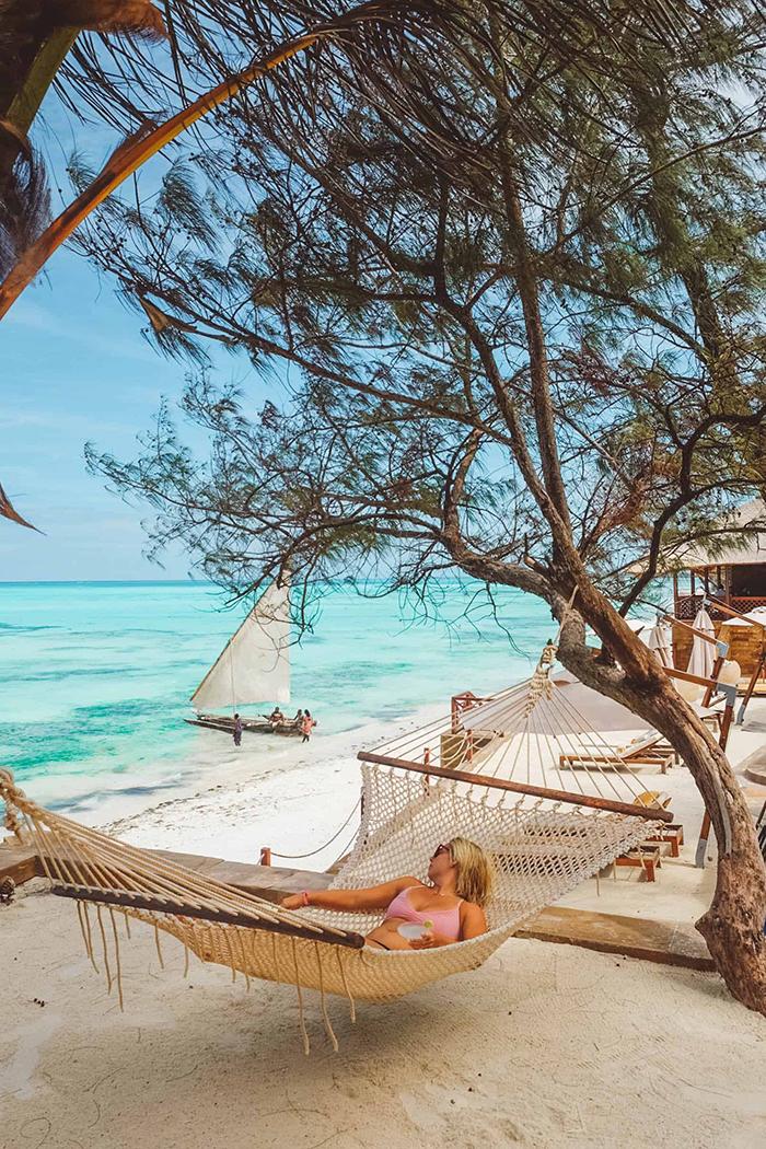 Woman in a hammock at the beach