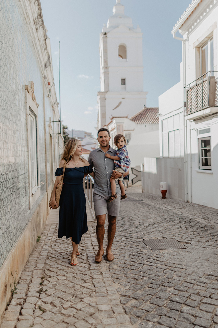 Family exploring the streets of Portugal