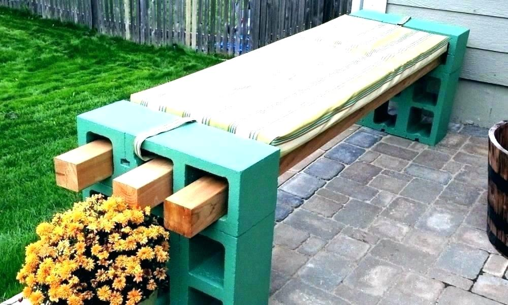 Bench made of bricks and a flower next to it