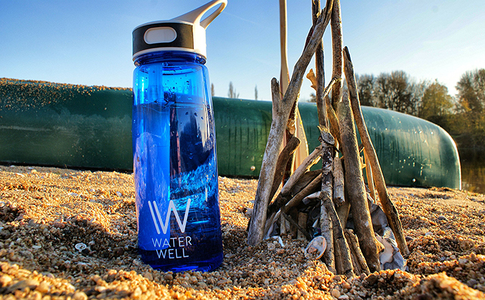 Water bottle with filter in the sand