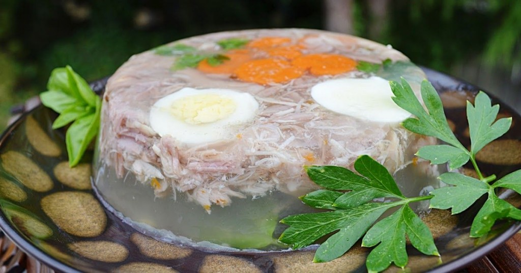 Aspic with pork meat, jelly, vegetables and boiled eggs