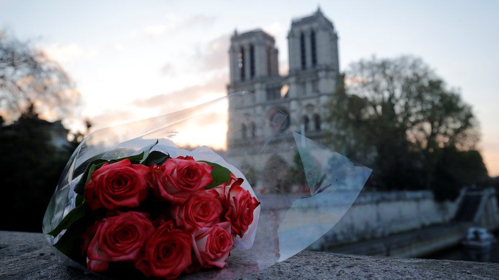 Flowers laid outside Notre-Dame cathedral in Paris