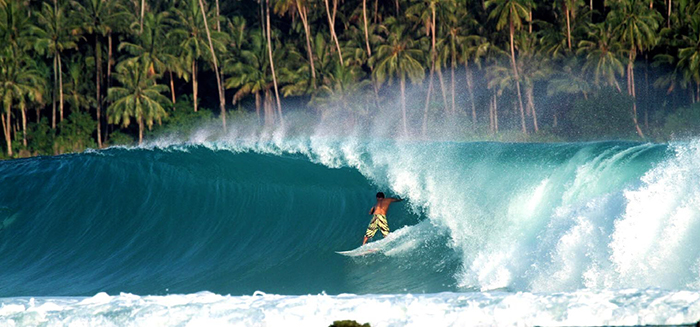 Surfing on big waves in Indonesia