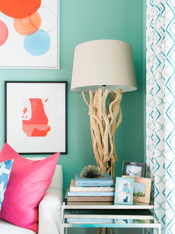 Coastal lamp in the corner with picture frames and books in front of it