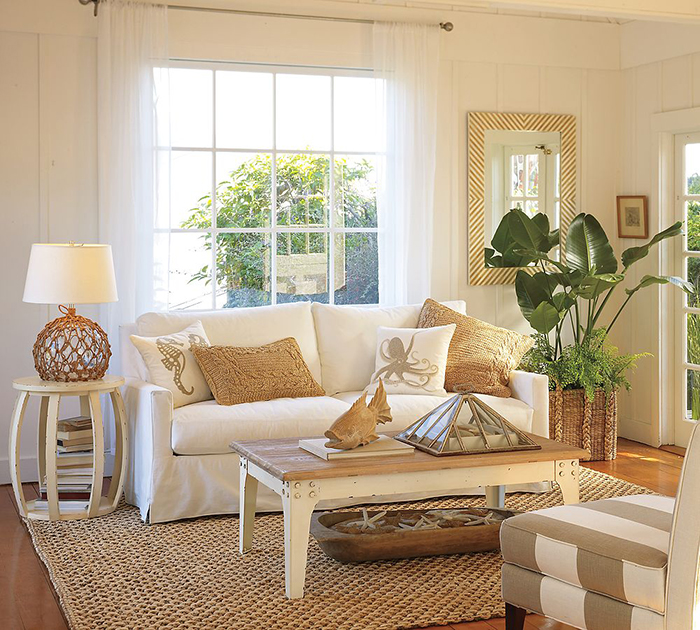 Natural fiber rug in the middle of a living room decorated with nice flowers