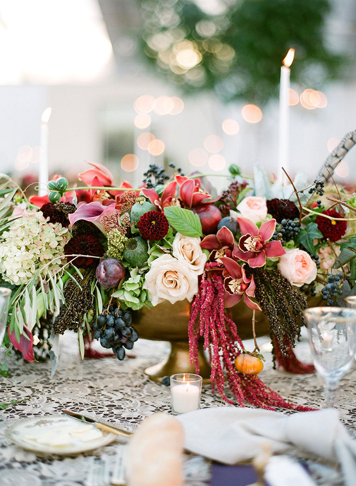Different kinds of flowers and candles around