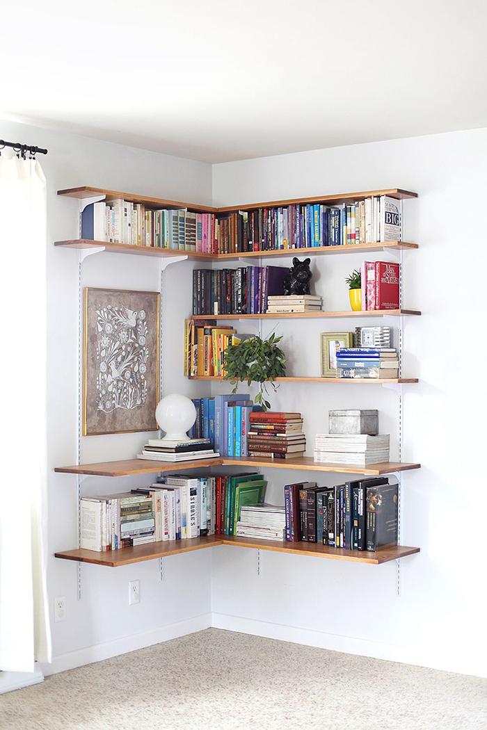Corner bookshelf in a bedroom