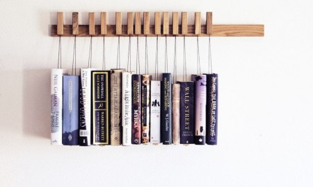 Hanging books on creative bookshelves
