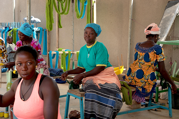 Three Afro american women making ethical clothes