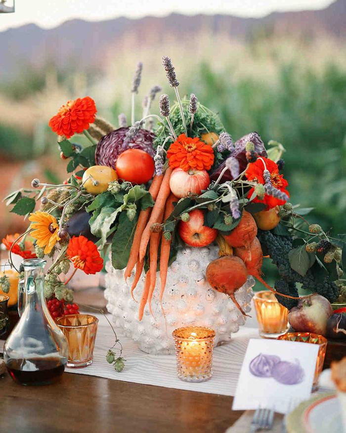 Fruits put in a big basket and surrounded with candles